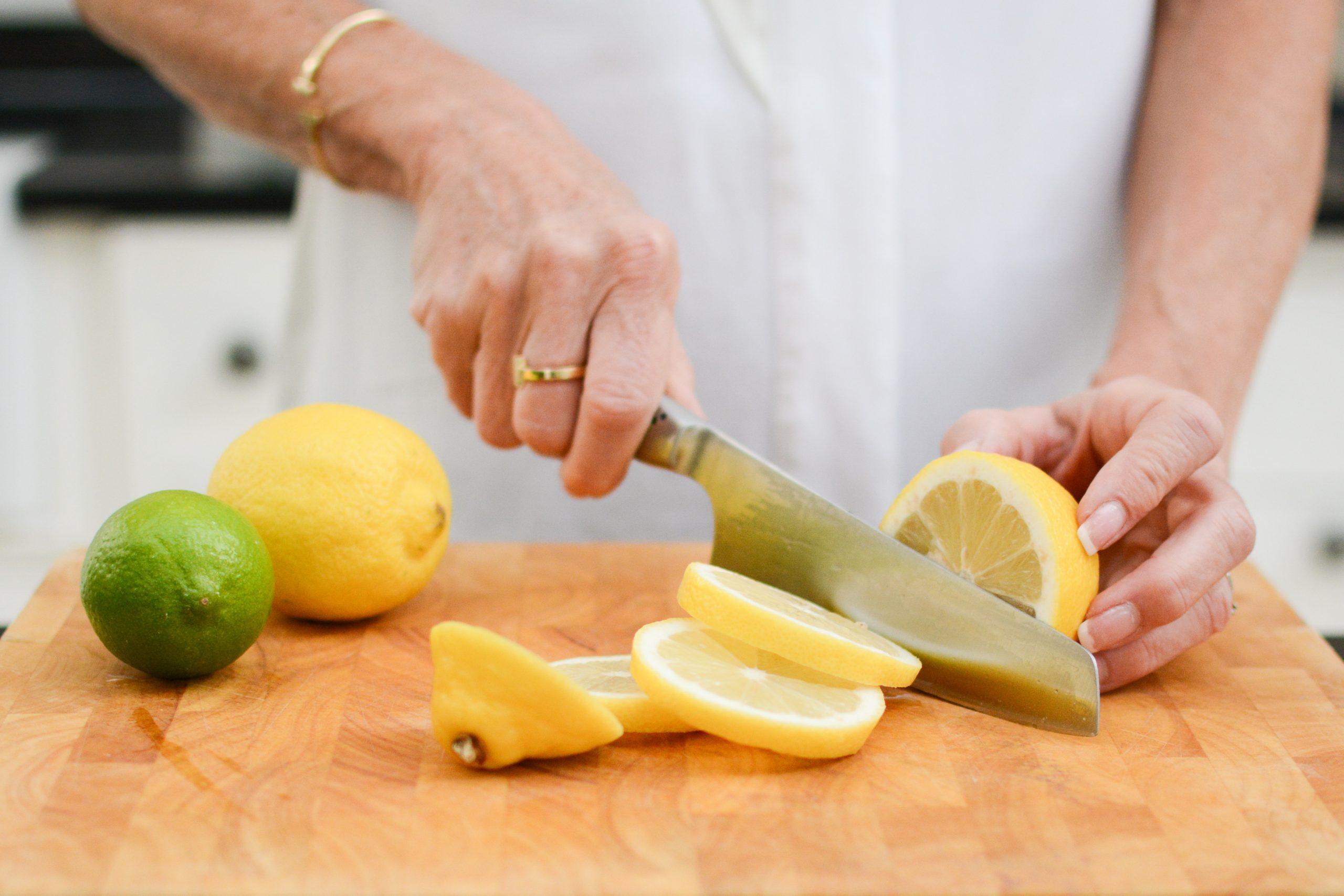 lady in white chopping lemons